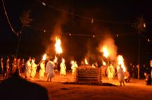 Lighting torches from the pyre